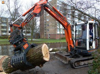 Kubota KX101 с захватом для деревьев